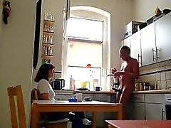 Brunette chick has breakfast with a naked man with a boner