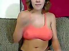 Busty blonde babe taking it off on her web cam