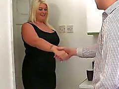 Chubby blonde with big tits fucks in kitchen