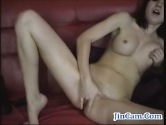 Gothic camgirl masturbates with finger on webcam