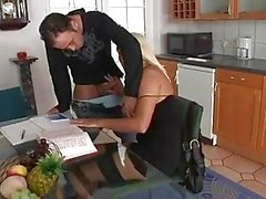 Heavy chested blonde momma in stockings sucks cock in kitchen