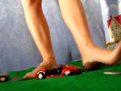 Blonde giantess heavily stomps many metal cars into crushed pancakes