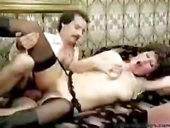 Classic porn with this horny brunette taking care of a bunch of cocks