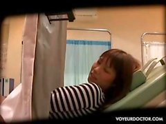 Hidden cam catches Asian babe getting a gynecologist exam
