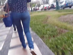 sexy young girl walking in jeans