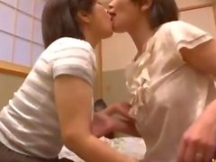 2 busty Asians kiss and go lez