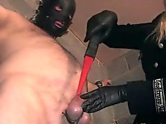 Cruel dominatrix spanking her subs cock