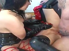 Two kinky girls in provocative outfits getting fucked rough in the ass