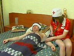Mature Nurse At Patient House