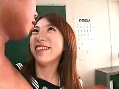 Two kinky Japanese schoolgirls kiss each other and stroke a
