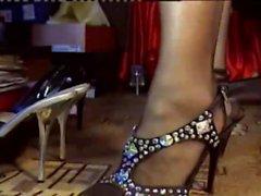 Woman models different high heele