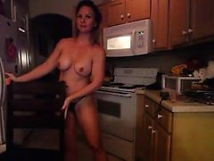 Busty hottie is naked in the kitchen and lies on the floor