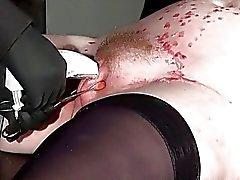 Punishment rack bondage of tattooed amateur slave