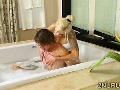 Tattooed blonde MILF massages a lucky stud in bathtub