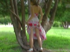 Young flashing naked blonde girl exhibition in public park