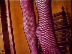 Mistress Amberle, in fishnets, walking all over her bound slave
