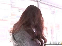 Brunette gets a massage on her perky ass in public