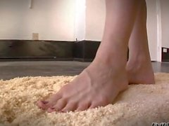 Ashley Fires plays with her feet