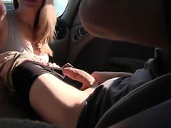 Blonde teen blowing in car in a supermarket parking