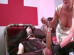 Mistress milking boy's cock with a penis pump machine