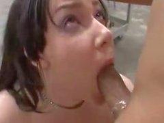 She sucks two black huge cocks