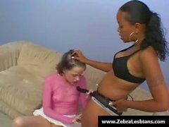 Zebra Girls - Ebony lesbian babes enjoy deep strap-on fuck 16