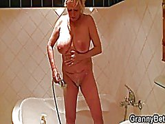 Busty blonde granny pleases him after shower
