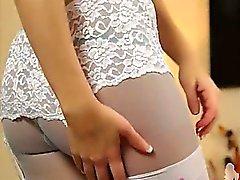 Lovely blond in white lingerie on sofa
