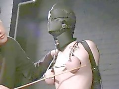 maskierten Sklaven gefoltert und gepackte