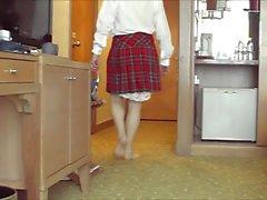 Red tartan skirt and slips hanging