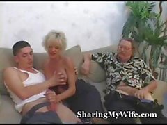 Busty mature blonde gets a young cock to bang while another dude jacks off