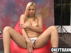 Busty shemale babe Angel Star tugs on her cock
