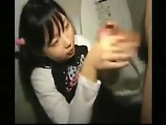 Pigtailed Japanese teen works her hands and lips on every i