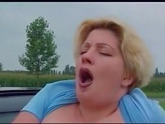Pissing action, bbw girl,piss from driving car window