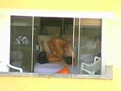 pareja follando con la ventana abierta