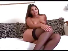 Sexy brunette masturbating with a bat