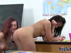 Two sexy schoolgirls bang in the classroom