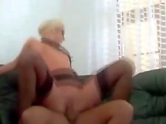 Delicious blond secretary in stockings seduces her boss