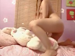 Extremely cute girl orgasms from intense dildoing
