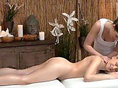 Classy masseuse rubbing lesbians pussy
