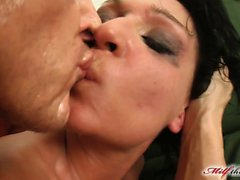 This big titted MILF is dressed in all black. She loves cock and begins by devouring our guy. She squirts like crazy as her pussy gets pounded and eats some cum