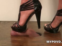 Brunette in high heels gives a foot job pov