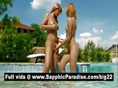 Amazing blonde lesbos fingering and licking pussy and having lesbo love at the pool