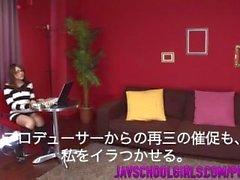 Rino Mizusawa smacks her hairy pussy with a stiff toy