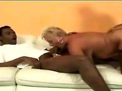 Granny Amanda enjoys 2 big black cocks with her tight anus