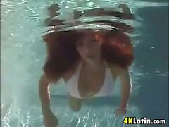 Latin Slut Gives A Blowjob In The Pool