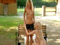Pair of horny lesbian blondes outdoor on a bench lick and spit their pussies