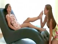 Sexy lesbian girl lick and suck her feet