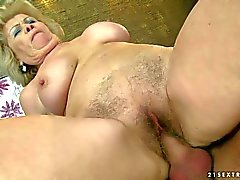 Big titted hairy granny Effie rides on top of cock