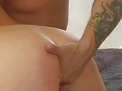 Tattooed stud gets blowjob from busty blonde slut
